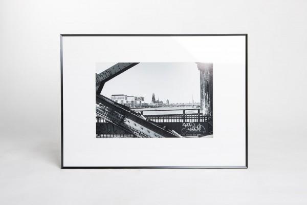 """Wechselrahmen Pixel 50 x 70 cm """"Dom-Südbrücke-Kranhäuser"""" schwarz/weiß"""