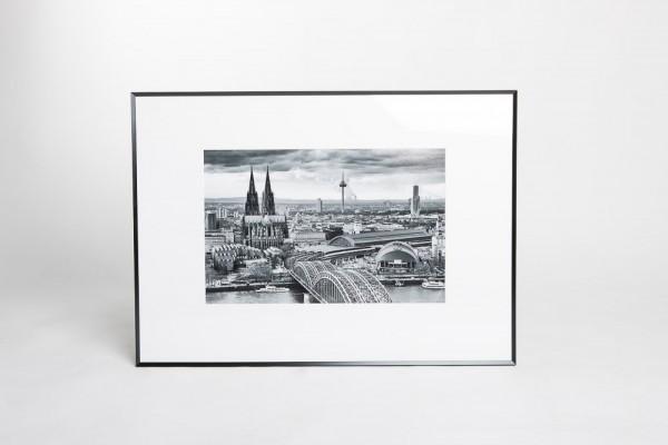 """Wechselrahmen Pixel 50 x 70 cm """"Köln von Oben"""" schwarz/weiß"""